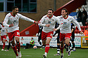 Craig Reid of Stevenage (c) celebrates after scoring their first goal with Jamaal Lascelles (l) and Lawrie Wilson . - Stevenage v Bury - npower League 1 - Lamex Stadium, Stevenage  - 5th May, 2012. © Kevin Coleman 2012