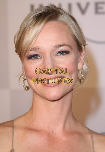 KARI MATCHETT.NBC Universal 68th Annual Golden Globe Awards After Party held at the Beverly Hilton, Beverly Hills, California, USA..January 16th, 2011.headshot portrait gold hoop earrings .CAP/ADM/CH.©Charles Harris/AdMedia/Capital Pictures