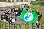 GREEN FLAG: Pupils at Brosna national school celebrating the unveiling of their fourth green flag last week with staff members, l-r: Mary Scanlon (Principal), Siobhan Lenihan, Noreen Murphy, John Cahill.