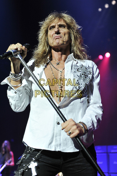WHITESNAKE - David Coverdale.Whitesnake performing live at the Hammersmith Apollo, London, England..June 20th, 2011.stage concert live gig performance music half length white shirt microphone jeans denim black chest necklaces .CAP/MAR.© Martin Harris/Capital Pictures.