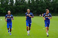 Clint Hill, Bobby Zamora and Armand Traore of QPR in training
