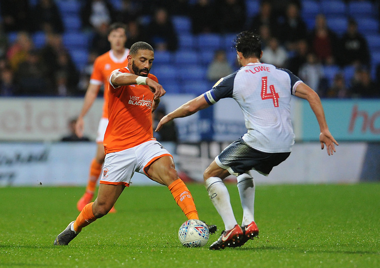 Blackpool's Liam Feeney under pressure from Bolton Wanderers' Jason Lowe<br /> <br /> Photographer Kevin Barnes/CameraSport<br /> <br /> The EFL Sky Bet League One - Bolton Wanderers v Blackpool - Monday 7th October 2019 - University of Bolton Stadium - Bolton<br /> <br /> World Copyright © 2019 CameraSport. All rights reserved. 43 Linden Ave. Countesthorpe. Leicester. England. LE8 5PG - Tel: +44 (0) 116 277 4147 - admin@camerasport.com - www.camerasport.com