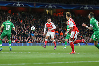 Alexis Sanchez of Arsenal (2nd left) looks one way while making a pass to Alex Oxlade-Chamberlain of Arsenal (2nd right) during the UEFA Champions League match between Arsenal and PFC Ludogorets Razgrad at the Emirates Stadium, London, England on 19 October 2016. Photo by David Horn / PRiME Media Images.