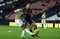 Chuks Aneke of MK Dons and Michael Rose of Macclesfield Town during MK Dons vs Macclesfield Town, Sky Bet EFL League 2 Football at stadium:mk on 17th November 2018