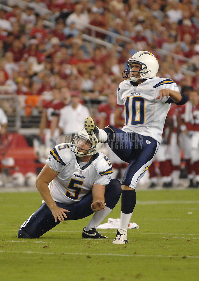 Aug 25, 2007; Glendale, AZ, USA; San Diego Chargers punter Mike Scifres (5) holds as kicker Nate Kaeding (10) kicks a field goal against the Arizona Cardinals at University of Phoenix Stadium. San Diego defeated Arizona 33-31. Mandatory Credit: Mark J. Rebilas-US PRESSWIRE