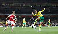 Josh Murphy of Norwich City hits a shot at goal with Riess Nelson of Arsenal looking on during the Carabao Cup match between Arsenal and Norwich City at the Emirates Stadium, London, England on 24 October 2017. Photo by Carlton Myrie.