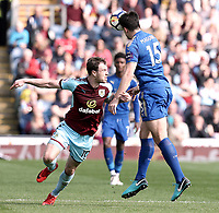 Leicester City's Harry Maguire clears under pressure from Burnley's Ashley Barnes<br /> <br /> Photographer Rich Linley/CameraSport<br /> <br /> The Premier League - Burnley v Leicester City - Saturday 14th April 2018 - Turf Moor - Burnley<br /> <br /> World Copyright &copy; 2018 CameraSport. All rights reserved. 43 Linden Ave. Countesthorpe. Leicester. England. LE8 5PG - Tel: +44 (0) 116 277 4147 - admin@camerasport.com - www.camerasport.com