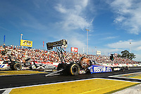 May 31, 2013; Englishtown, NJ, USA: NHRA top fuel dragster driver Antron Brown (right) races alongside Spencer Massey during qualifying for the Summer Nationals at Raceway Park. Mandatory Credit: Mark J. Rebilas-