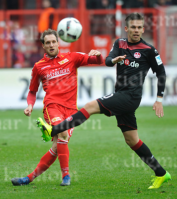 Apr-16-2017,Stadium Alte F&ouml;rsterei,Berlin,Germany<br /> 2nd Bundesliga - gameday 29 1.FC Union Berlin - 1.FC Kaiserslautern <br /> Scorer Sebastian Polter,m,happy in the rain with teammates<br /> Union`s Stephan F&uuml;rstner ,l,battles for the ball with Zolt&aacute;n Stieber