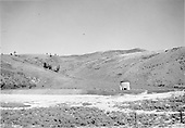 A distant view of D&amp;RGW Los Pinos water tank.<br /> D&amp;RGW  Los Pinos, CO