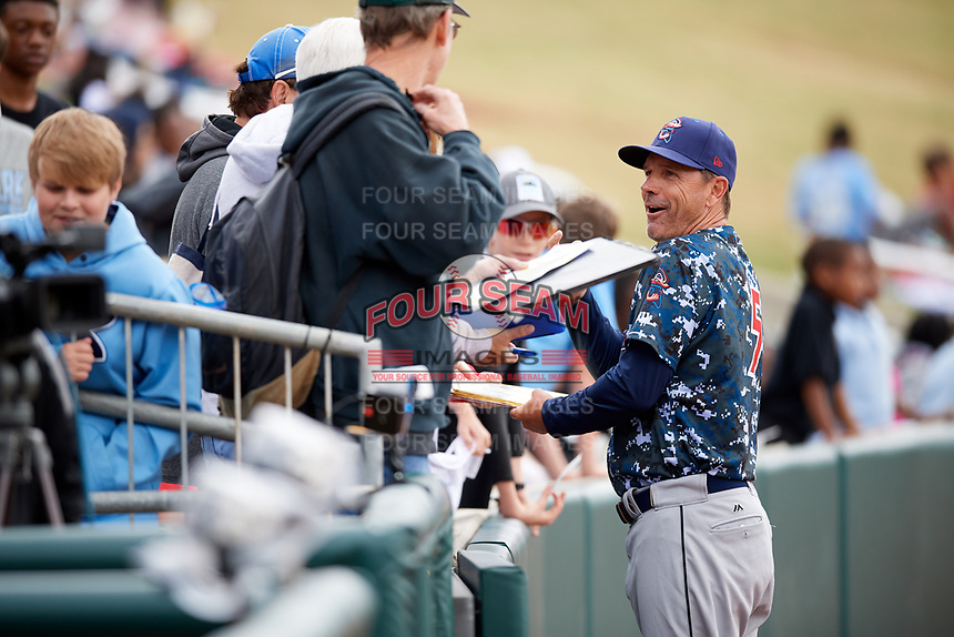 Jacksonville Jumbo Shrimp manager Randy Ready (5) signs autographs for fans before a game against the Birmingham Barons on April 24, 2017 at Regions Field in Birmingham, Alabama.  Jacksonville defeated Birmingham 4-1.  (Mike Janes/Four Seam Images)