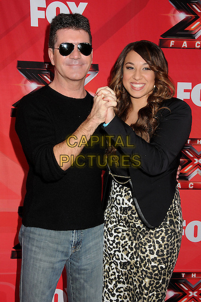 """Simon Cowell and Melanie Amaro.FOX's """"The X Factor"""" Press Conference held at CBS Television City, Los Angeles, California, USA..December 19th, 2011.full length black jacket leopard print dress brown beige top jeans denim sunglasses shades hands holding .CAP/ADM/BP.©Byron Purvis/AdMedia/Capital Pictures."""