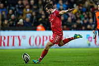 Dan Jones of the Scarlets scores with a kick during the Guinness Pro14 Round 11 match between the Ospreys and the Scarlets at the Liberty Stadium, Swansea, Wales, UK. Saturday 22 December 2018