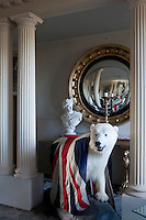 Another polar bear draped in a Union Jack stands between a pair of fluted columns in the entrance hall