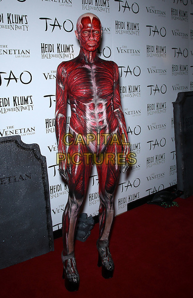 Heidi Klum.Heidi Klum's 12th Annual Halloween Party at Tao Nightclub at the Venetian, Las Vegas, Nevada, USA, .29th October 2011..full length dressed up costume hallwe'en make-up bald body art face paint contacts contact lenses dead body blood  skinless  teeth muscles platform shoes  .CAP/ADM/MJT.© MJT/AdMedia/Capital Pictures.