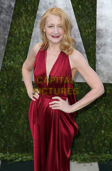 Patricia Clarkson.2013 Vanity Fair Oscar Party following the 85th Academy Awards held at the Sunset Tower Hotel, West Hollywood, California, USA..February 24th, 2013.oscars half length red silk satin dress hands on hips.CAP/ADM/SLP/DOW.©Dowling/StarlitePics/AdMedia/Capital Pictures