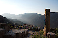 DELPHI, GREECE - APRIL 11 : A general view of the Sanctuary of Apollo overlooking the Treasury of the Boeotians with the slopes of the Mount Parnassus in the distance at dawn, on April 11, 2007 in Delphi, Greece. (Photo by Manuel Cohen)