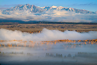 Teton National Park, Wyoming:<br /> Lingering fog in the Snake River valley with the Teton range in morning light
