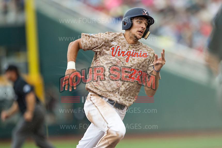 Virginia Cavaliers shortstop Daniel Pinero (22) runs to third base against the Arkansas Razorbacks in Game 1 of the NCAA College World Series on June 13, 2015 at TD Ameritrade Park in Omaha, Nebraska. Virginia defeated Arkansas 5-3. (Andrew Woolley/Four Seam Images)