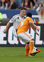 CARSON, CA - DECEMBER 01, 2012:   Robbie Keane (7) of the Los Angeles Galaxy moves the ball away from Corey Ashe (26) of the Houston Dynamo during the 2012 MLS Cup at the Home Depot Center, in Carson, California on December 01, 2012. The Galaxy won 3-1.