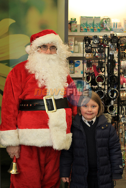 Millie with Santa at the Christmas Customer Day in the Cottage Pharmacy 2011...(Photo credit should read Jenny Matthews www.newsfile.ie)....This Picture has been sent you under the conditions enclosed by:.Newsfile Ltd..The Studio,.Millmount Abbey,.Drogheda,.Co Meath..Ireland..Tel: +353(0)41-9871240.Fax: +353(0)41-9871260.GSM: +353(0)86-2500958.email: pictures@newsfile.ie.www.newsfile.ie.