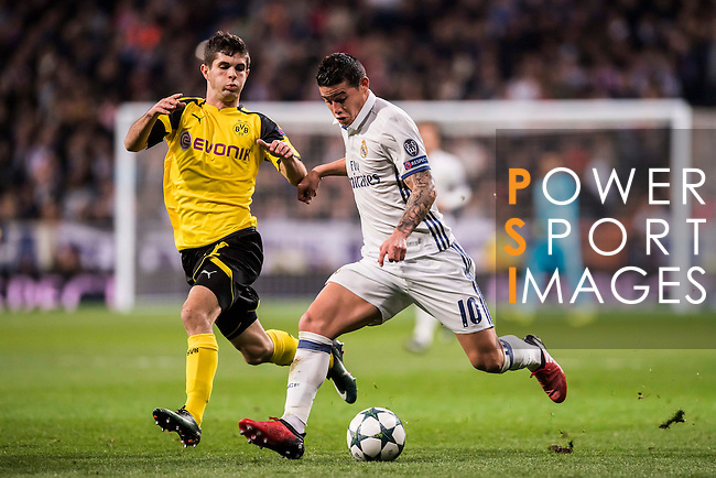 James Rodriguez (r) of Real Madrid competes for the ball with Christian Pulistic of Borussia Dortmund during the 2016-17 UEFA Champions League match between Real Madrid and Borussia Dortmund at the Santiago Bernabeu Stadium on 07 December 2016 in Madrid, Spain. Photo by Diego Gonzalez Souto / Power Sport Images
