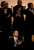 United States President Barack Obama listens during song at Vermont Avenue Baptist Church, Sunday, January 17, 2010 in Washington, DC.  President Obama spoke during a service in honor of civil rights leader Dr. Martin Luther King Jr.  .Credit: Brendan Smialowski - Pool via CNP