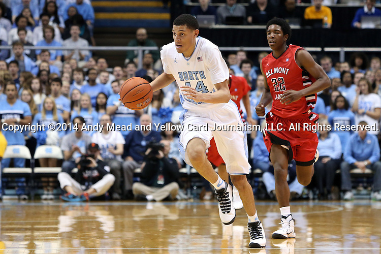 07 November 2014: North Carolina's Justin Jackson (44) and Belmont Abbey's Markel Pollard (22). The University of North Carolina Tar Heels played the Belmont Abbey College Crusaders in an NCAA Division I Men's basketball exhibition game at the Dean E. Smith Center in Chapel Hill, North Carolina. UNC won the game 112-34.