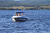 Three adults in a  motorboat on lake Maskinonge,