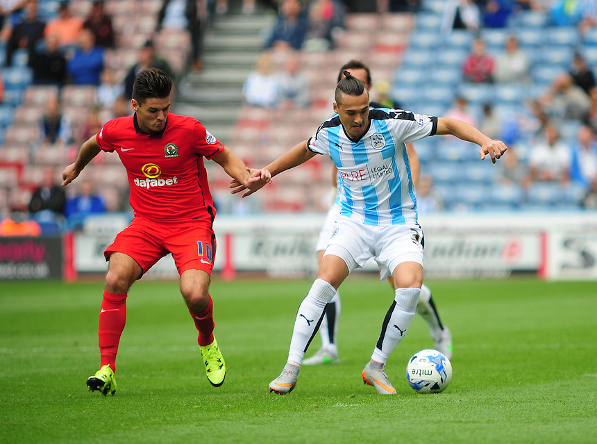 Huddersfield Town's Jason Davidson looks to get past Blackburn Rovers' Ben Marshall<br /> <br /> Photographer Andrew Vaughan/CameraSport<br /> <br /> Football - The Football League Sky Bet Championship - Huddersfield Town v Blackburn Rovers - Saturday 15th August 2015 - The John Smith's Stadium - Huddersfield<br /> <br /> &copy; CameraSport - 43 Linden Ave. Countesthorpe. Leicester. England. LE8 5PG - Tel: +44 (0) 116 277 4147 - admin@camerasport.com - www.camerasport.com