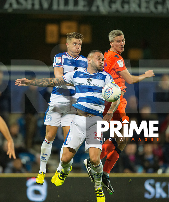 QPR Jake Bidwell and Joel Lynch and Millwall's Steve Morison during the Sky Bet Championship match between Queens Park Rangers and Millwall at Loftus Road Stadium, London, England on 19 September 2018. Photo by Andrew Aleksiejczuk / PRiME Media Images.