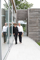 Portrait of designers Ben Langlands and Nikki Bell outside their eco off-grid house 'Untitled' which they had built using a prefabricated building system, Kent, UK