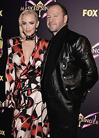 "WEST HOLLYWOOD - DECEMBER 13:  Jenny McCarthy and Donnie Wahlberg at the premiere karaoke event for season one of ""The Masked Singer"" at The Peppermint Club on December 13, 2018 in West Hollywood, California. (Photo by Scott Kirkland/Fox/PictureGroup)"