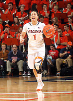 Virginia guard China Crosby (1) handles the ball during an NCAA college basketball game in Charlottesville, Va. Duke defeated Virginia 62-41...