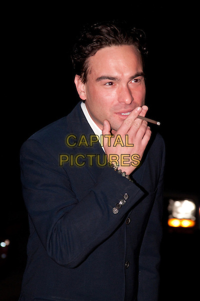 "JOHNNY GALECKI.The Academy of Television Arts & Sciences,  An Evening With ""The Big Bang Theory,"" at the Leonard H. Goldenson Theatre, North Hollywood, CA, USA. February 18, 2010. .half length blue jacket hand smoking cigarette cigar .CAP/CEL/RL.©Rich Linton/CelPh/Capital Pictures."