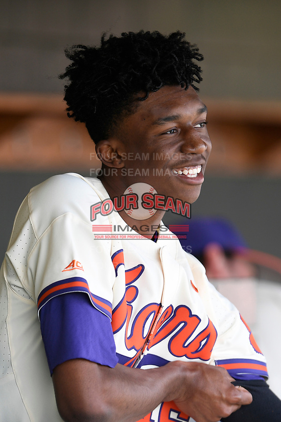 Starting pitcher Keyshawn Askew (46) of the Clemson Tigers waits in the dugout between innings of a game against the Charlotte 49ers on Monday, February 18, 2019, at Doug Kingsmore Stadium in Clemson, South Carolina. Clemson won, 7-6. (Tom Priddy/Four Seam Images)