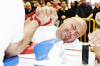 "Chris Perka tries to take an opponent down at the Empire State Finals at the Port Authority Bus Terminal in New York City on November 17, 2005.  The Empire State Finals is the culmination in the year of the New York City Arm Wrestling Association's ""Golden Arm Series""."
