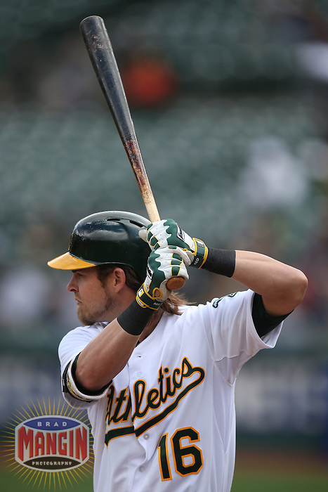 OAKLAND, CA - APRIL 2:  Josh Reddick #16 of the Oakland Athletics bats against the Cleveland Indians during the game at O.co Coliseum on Wednesday, April 2, 2014 in Oakland, California. Photo by Brad Mangin