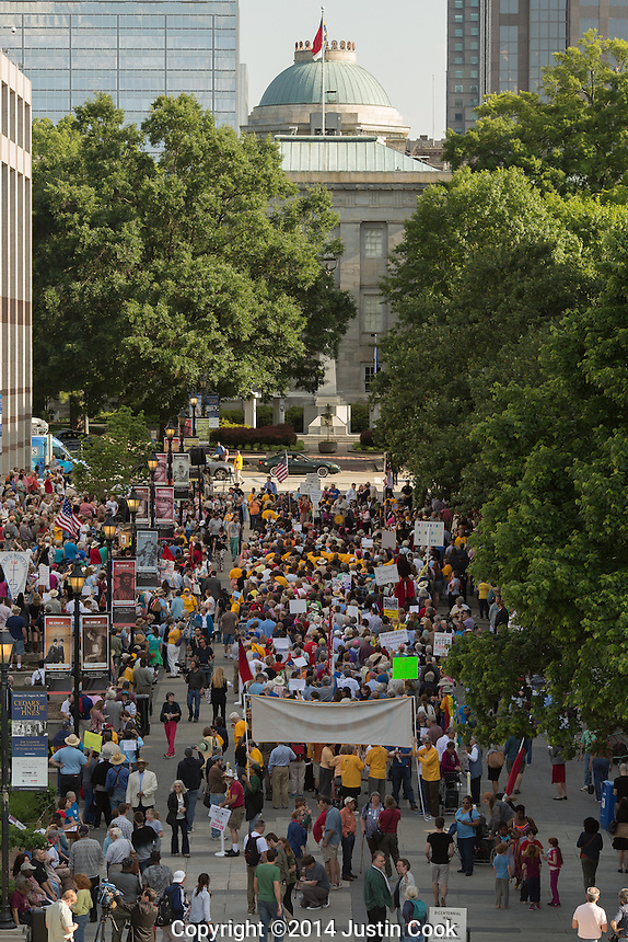 The first Moral Monday of 2014 at Bicentennial Plaza as seen from the top of the North Carolina Legislative building in Raleigh , N.C. on Monday, May 19, 2014. (Justin Cook)<br /> <br /> Since 2013 hundreds of people have gathered on Mondays when the North Carolina Legislature is in session to peacefully protest what they feel is a an extreme conservative agenda that endangers education, the poor, the unemployed, voting rights and organized labor in North Carolina. Many of the nonviolent protestors deliberately get arrested in acts of civil disobedience.