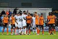 Kyle Bartley of Swansea tries to calm down Barnet's Curtis Weston (No 8) after a second half skirmish during Barnet vs Swansea City, Friendly Match Football at the Hive Stadium on 12th July 2017