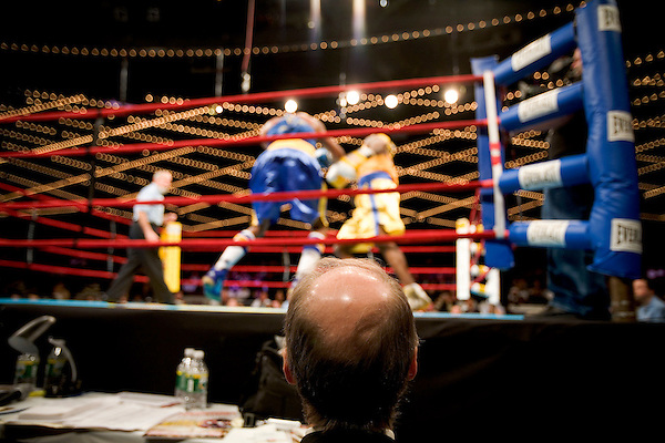 A ringside doctor watches the fights.. Thursday was the first night of the finals of the  79th annual Golden Glove Boxing tournament. Boxers from all over the New York who made it through the previous rounds were on hand at Madison Square Garden to compete for the coveted Golden Gloves Champion title.