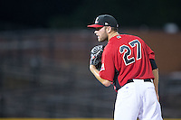 Hickory Crawdads relief pitcher Austin Pettibone (27) looks to his catcher for the sign against the Savannah Sand Gnats at L.P. Frans Stadium on June 15, 2015 in Hickory, North Carolina.  The Crawdads defeated the Sand Gnats 4-1.  (Brian Westerholt/Four Seam Images)