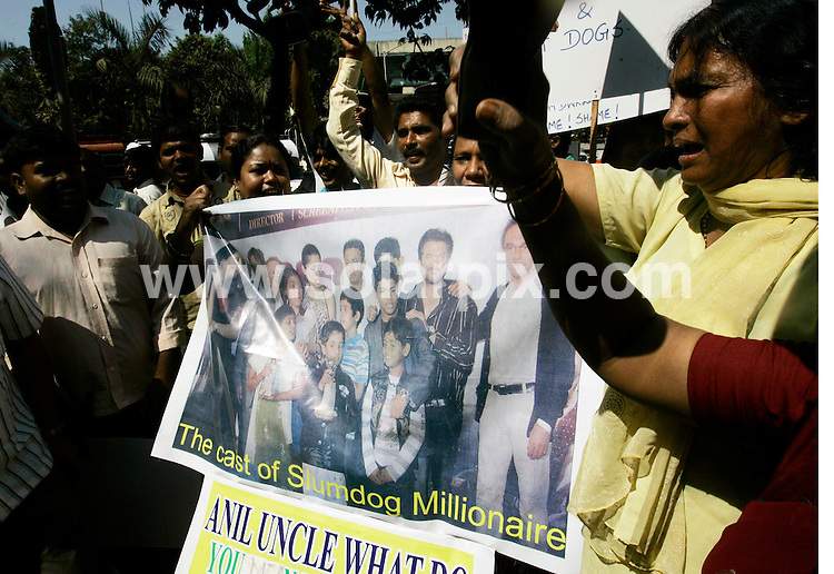 **ALL ROUND PICTURES FROM SOLARPIX.COM**.**WORLDWIDE SYNDICATION RIGHTS**.Residents of Asia's largest shanty town, Dharavi, display posters and placards as they protest against the producers of film 'Slumdog Millionaire' in Mumbai February 3, 2009. In recent weeks the movie's success around the world has been overshadowed by objections in India to the name, which some slum dwellers find offensive, its depiction of the lives of impoverished Indians and the treatment of the cast. Mumbai, India. 3 Feb 2009. ..This pic: Slumdog Millionaire protest..JOB REF: 9578 SJA        DATE: 03_02_2009.**MUST CREDIT SOLARPIX.COM OR DOUBLE FEE WILL BE CHARGED**.**MUST NOTIFY SOLARPIX OF ONLINE USAGE**.**CALL US ON: +34 952 811 768 or LOW RATE FROM UK 0844 617 7637**
