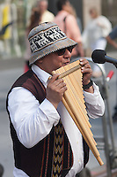 A musician plays a Peruvian bamboo flute during the 2011 New York City Easter Parade.
