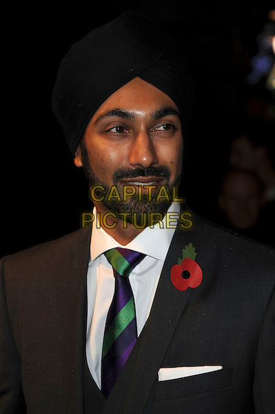 Kulveer Ranger.Evening Standard 1000 most Influential people in London, London Transport Museum, London, England..November 8th, 2011.headshot portrait black turban grey gray suit beard facial hair poppy blue green stripe tie.CAP/CAS.©Bob Cass/Capital Pictures.