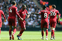 Georginio Wijnaldum of Liverpool is congratulated after scoring the first goal during Tottenham Hotspur vs Liverpool, Premier League Football at Wembley Stadium on 15th September 2018