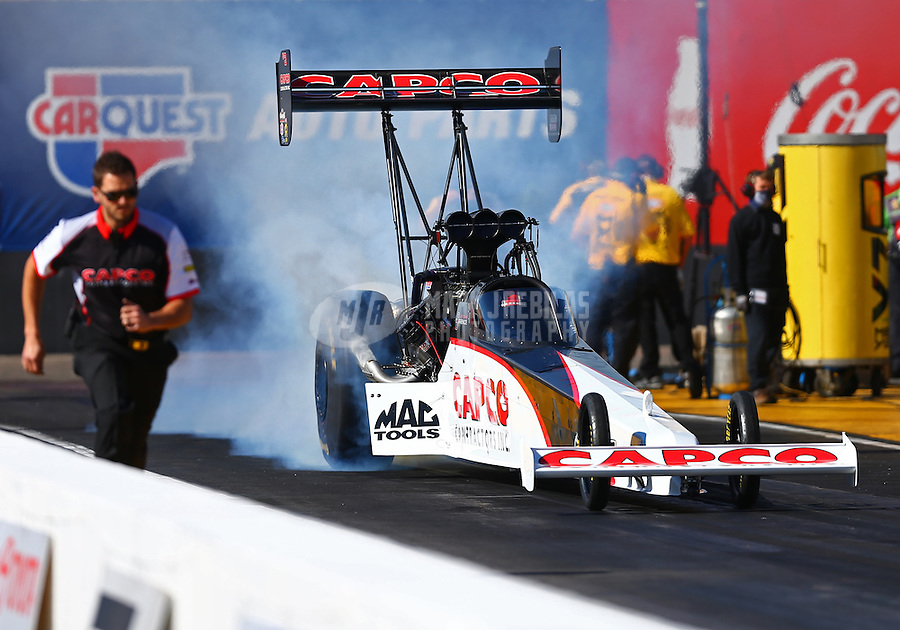 Feb 24, 2017; Chandler, AZ, USA; NHRA top fuel driver Steve Torrence does a burnout during qualifying for the Arizona Nationals at Wild Horse Pass Motorsports Park. Mandatory Credit: Mark J. Rebilas-USA TODAY Sports