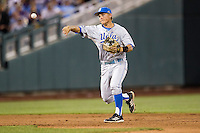 UCLA Bruin shortstop Pat Valaika (10) makes a throw to first base during Game 4 of the 2013 Men's College World Series against the LSU Tigers on June 16, 2013 at TD Ameritrade Park in Omaha, Nebraska. UCLA defeated LSU 2-1. (Andrew Woolley/Four Seam Images)