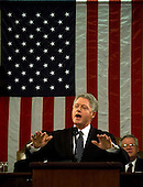 "United States President Bill Clinton delivers the State of the Union Address in front of the American Flag before a Joint Session of Congress in Washington, D.C. on January 19, 1999.  Clinton said, ""I stand before you to report that the state of our union is strong.""  In the background at right is the Speaker of the U.S. House Dennis Hastert (Republican of Illinois).  .Credit: Win McNamee / Pool via CNP"
