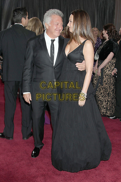 Dustin Hoffman, Lisa Gottsegen.85th Annual Academy Awards held at the Dolby Theatre at Hollywood & Highland Center, Hollywood, California, USA..February 24th, 2013.oscars full length dress profile married husband wife black white tie suit shirt  side profile smiling .CAP/ADM/RE.©Russ Elliot/AdMedia/Capital Pictures.
